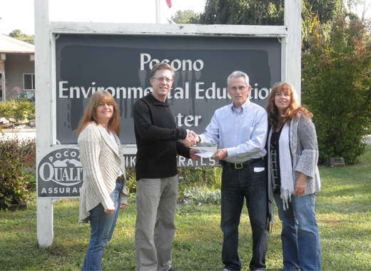peec accepts a generous donation from saw creek estates
